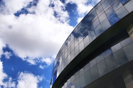 glass building: Office building on the blue sky background  with clouds