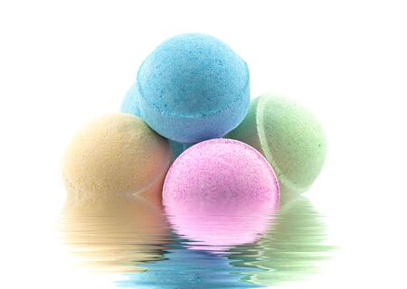 Bath bombs in the water with reflections
