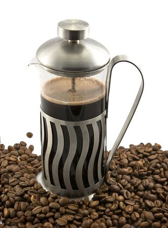 making coffee: French press with hot coffee and beans
