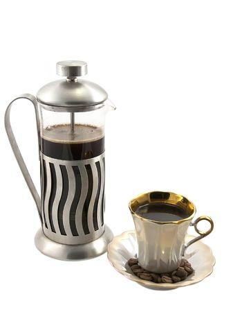 percolator: French press with cup of coffee on white