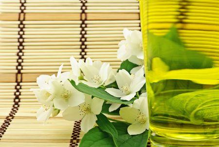 Fresh green tea with jasmin white flowers photo
