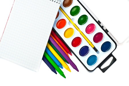 paintbox: Paintbox, crayons and note book Stock Photo