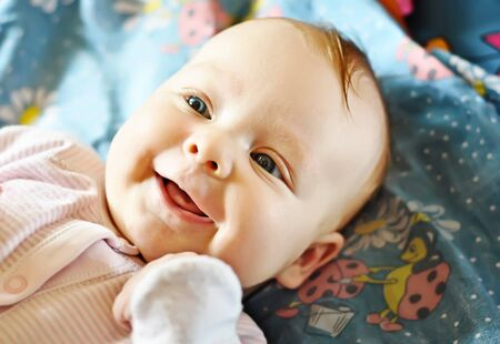 baby facial expressions: Baby-girl Stock Photo