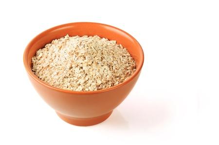 #description#}dry oat grains in brown clay bowl photo