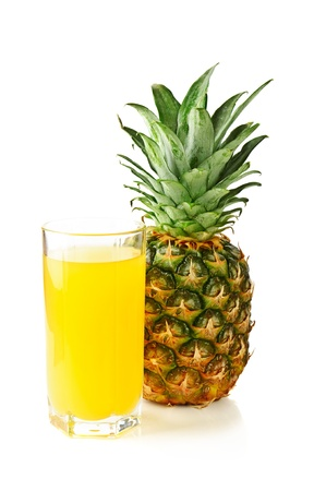 Glass with fresh pineapple photo