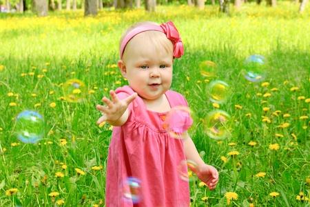 Outdoor portrait of a cute little girl photo