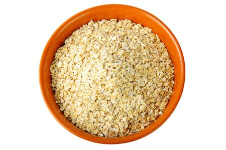 dry oat grains in brown clay bowl photo