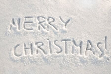 Merry christmas  text on snow photo