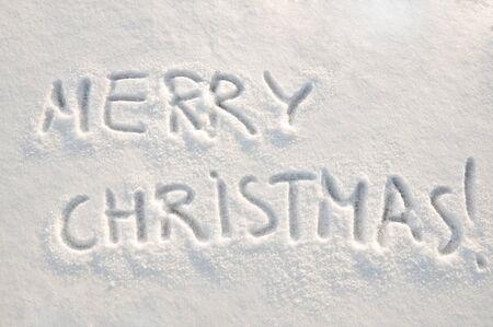 Merry christmas  text on snow Zdjęcie Seryjne