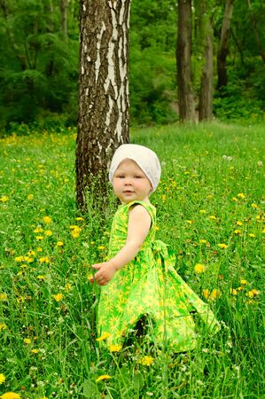 Outdoor portrait of a cute little girl photo