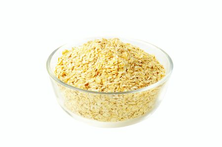 dry oat grains in the glass bowl photo