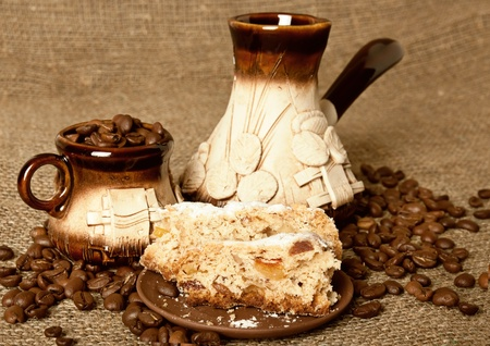 Clay set for coffee with pie on the sack background photo