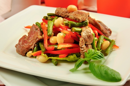 Salad with meat and vegetables photo