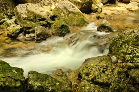 Fast flowing water photo