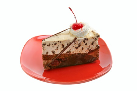 Chocolate cake on red dish photo