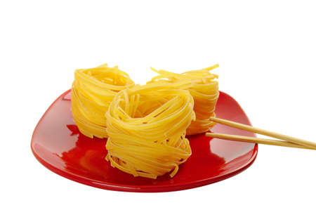 Pasta nests on a dish photo