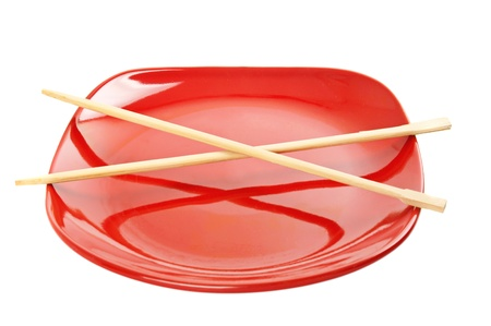 Red plate with chinese sticks Stock Photo - 19016474