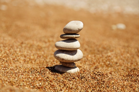 Cairn on the sand photo