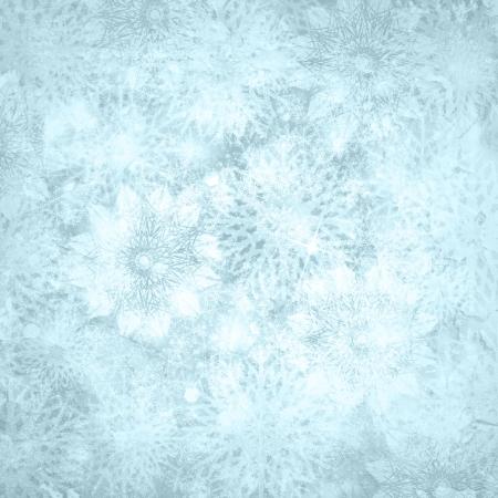 Kerstmis glanzende textuur sneeuw achtergrond met sneeuwvlokken en kopieer de ruimte in het blauw zilver kleuren Stockfoto