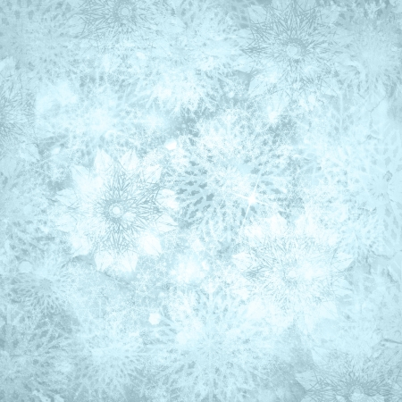 Christmas shiny textured  snow background with snowflakes and copy space in blue silver colors