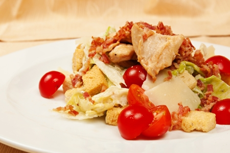Classic caesar salad on a dish in restaurant photo