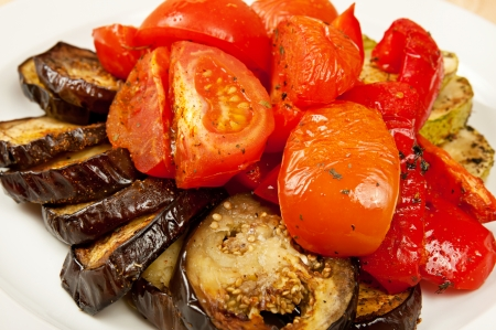 Grilled eggplant and tomatoes on the dish in restaurant photo