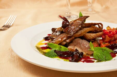 Roasted sliced goose on dish in restaurant photo