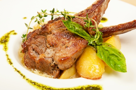 Roasted sheep meat with potatoes on dish  in restaurant