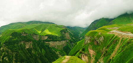 Green caucasus  mountains panoramic cloudy landscape in Georgia, natural background photo