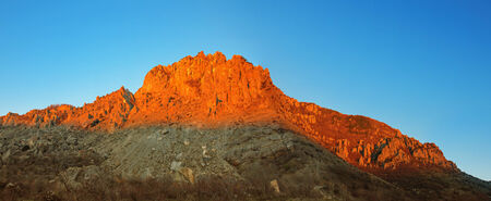 Panorama of the erd Demerji mountain at sunset with blue sk