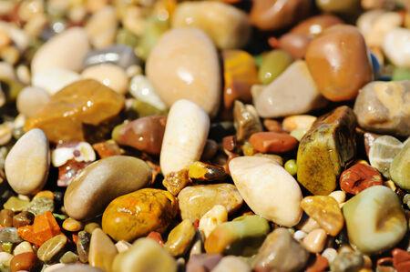 Sea pebble colorful vivid wet background, macro, shallow depth of field photo