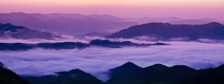 Mountain foggy sunrise photo