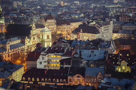 western european: Night view of western european city Lviv, architecture background in vintage hipster style