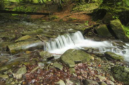flowing river: Mountain fast flowing river Shipot waterfall stream of water in the rocks