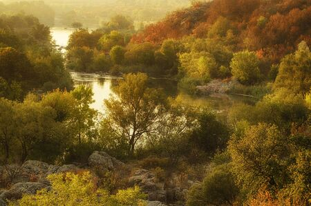 trees seasonal: Rural autumn sunrise soft landscape with river and  colorful trees, seasonal background Stock Photo