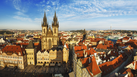 eastern european: Old Town Square with  Church of Our Lady before Tyn in eastern european Czech capital Prague - panoramic sunny view from Town Hall Stock Photo