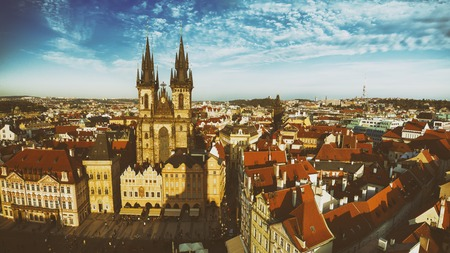 eastern european: Old Town Square with  Church of Our Lady before Tyn in eastern european Czech capital Prague - panoramic vintage  sunny view from Town Hall
