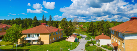 urban idyll: Panoramic view of typical small swedish town Vallentuna at summer time with blue sky and clouds Stock Photo