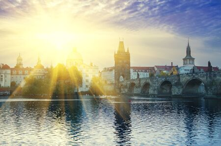 capita: Morning sunny view of famous european Prague city - the capita of Czech republic with reflection in river Vltava and historical bridges Stock Photo