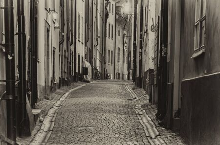 gamla stan: The narrow street of Gamla Stan - historic city old center of Stockholm, at summer night - black and white monochrome style