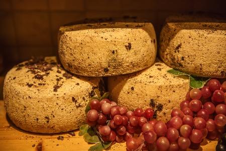pienza: Traditional italian pecorino cheese in the organic shop in Pienza, Italy