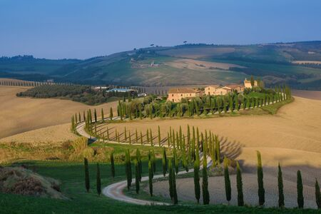 Villa in Tuscany with cypress road, idyllic seasonal nature landscape vintage hipster background Banque d'images