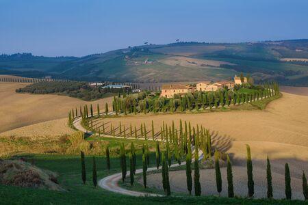 Villa in Tuscany with cypress road, idyllic seasonal nature landscape vintage hipster background 免版税图像