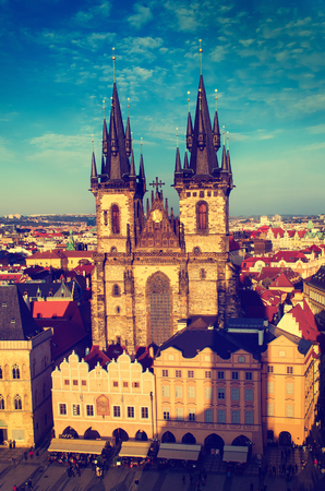eastern european: Old Town Square with Church of Our Lady before Tyn in eastern european Czech capital Prague -vintage view from Town Hall Stock Photo