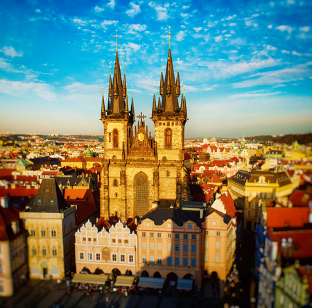 tyn: Old Town Square with Church of Our Lady before Tyn in eastern european Czech capital Prague - panoramic sunny view from Town Hall with tilt-shift effect.