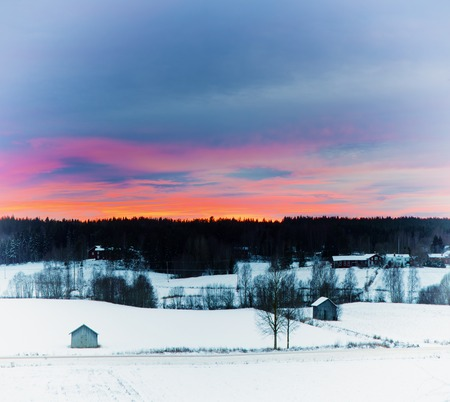 scandinavian winter: Winter sunset landscape with dramatic sky in Sweden, north scandinavian seasonal hipster background.