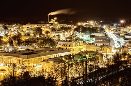View of small swedish european town Soderhamn at night, industrial background with evening illumination Standard-Bild