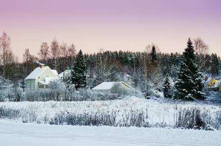 urban idyll: View of small swedish european town Soderhamn at pink sunset, winter seasonal background