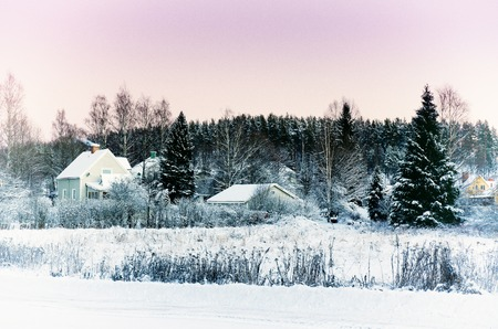 urban idyll: View of small swedish european town Soderhamn at pink sunset, winter seasonal background