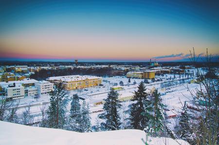 urban idyll: View of small swedish european town Soderhamn at sunrise, winter seasonal background